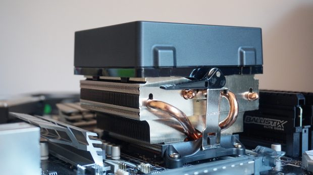 This cooler for an AMD Ryzen CPU has pesky metal arms that need to be secured with a lever.