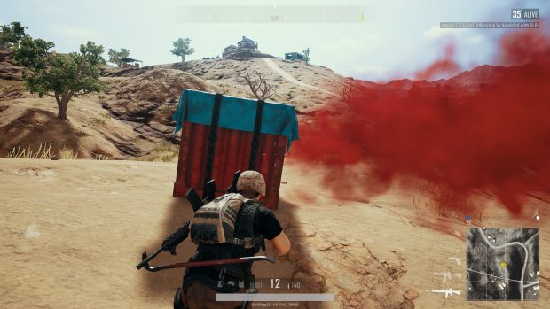 Player approaching a crate dropped from a plane