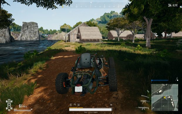 Player driving in a dune buggy near houses and water