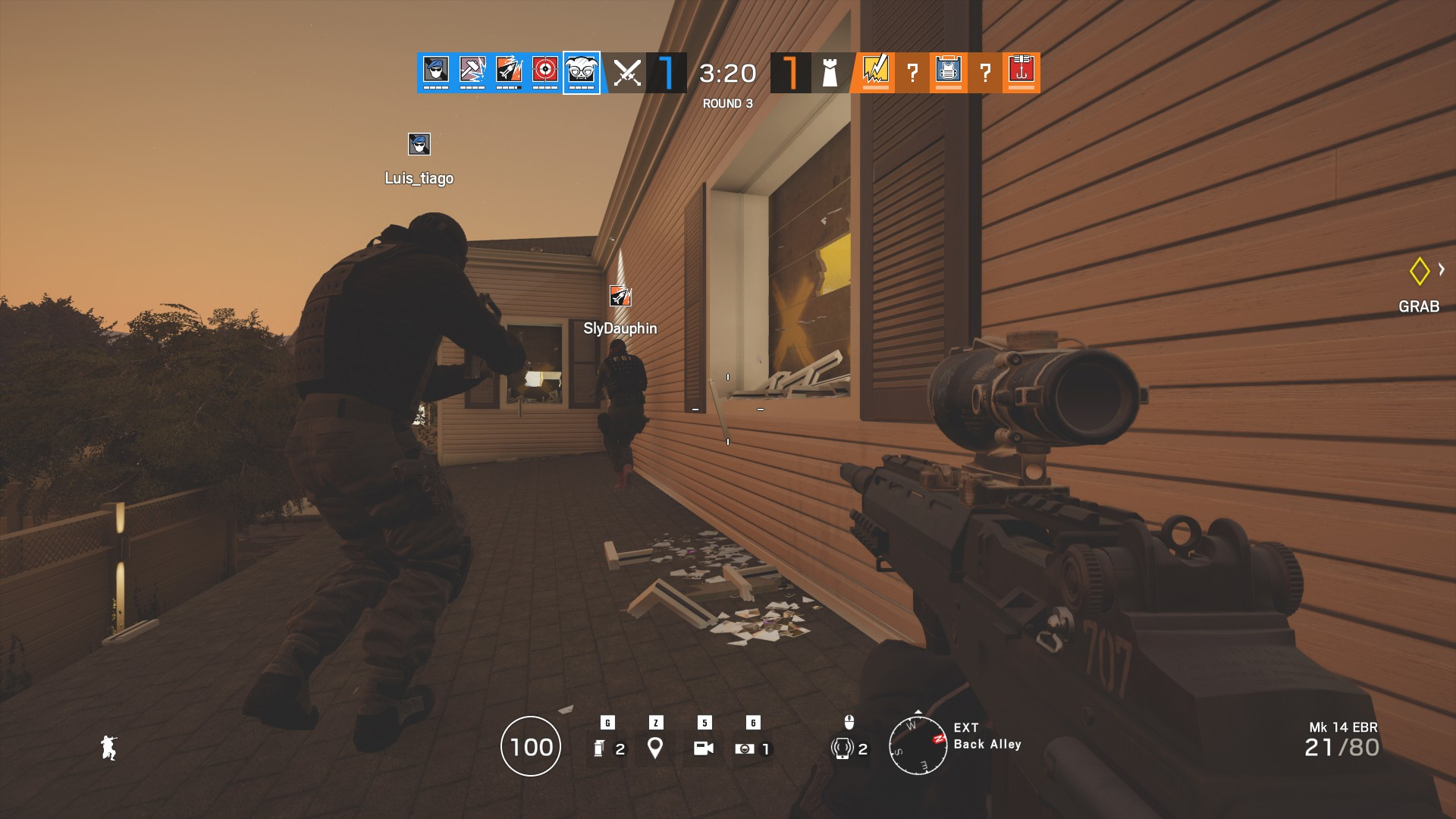 Operator playing as Dokkaebi with two other operators hanging outside as the defender Smoke's poison gas erupts inside the building.