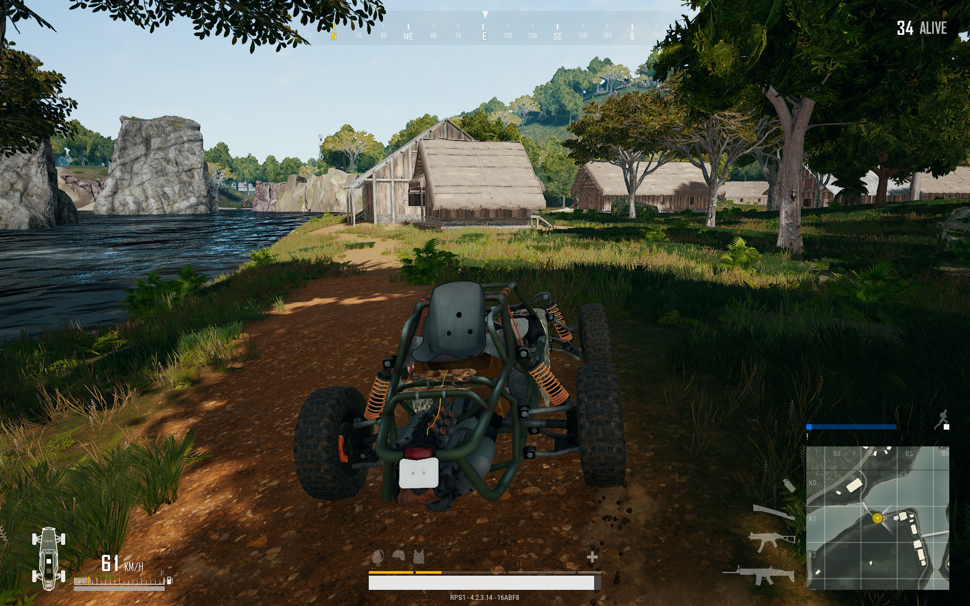 Player driving in dune buggy near houses and water