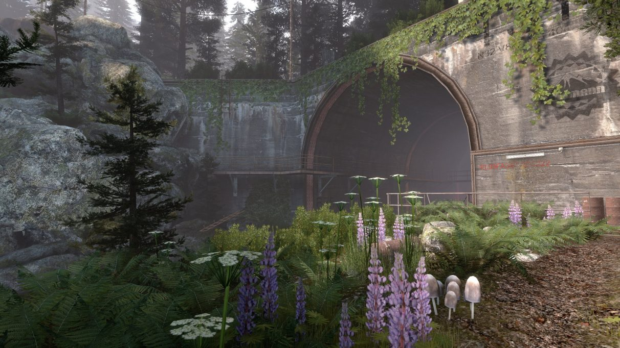 The verdant entrance to a tunnel in an Infra screenshot.