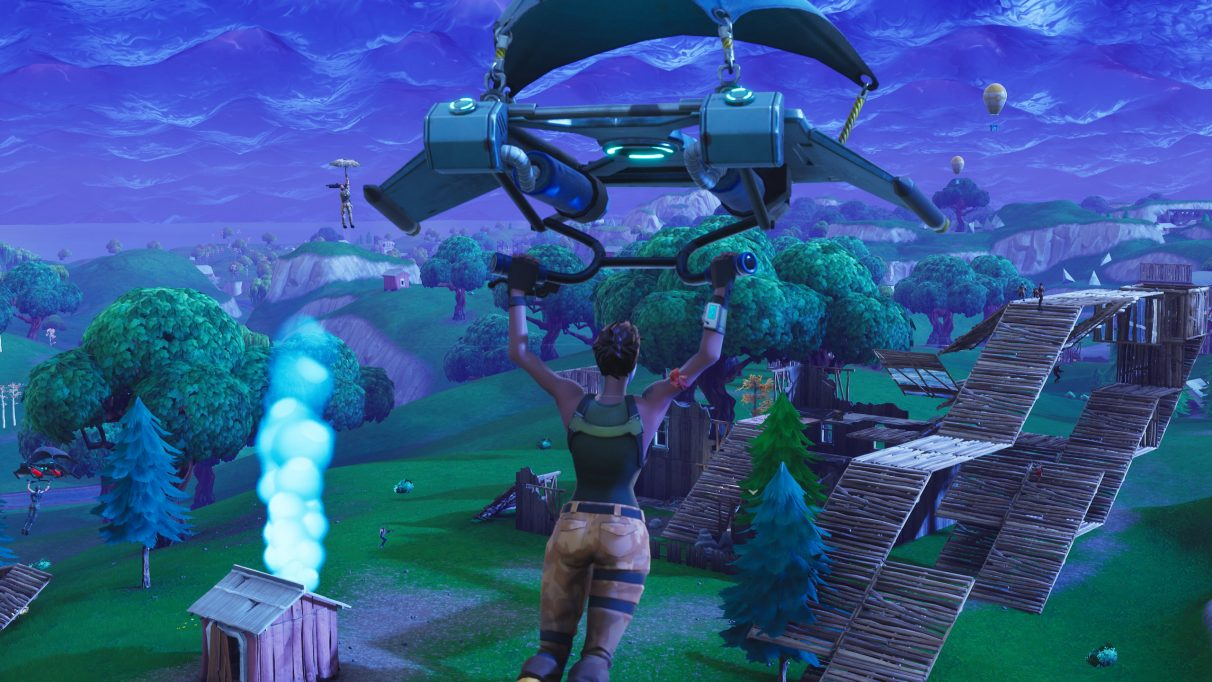Parachuting into the Fortnite map.