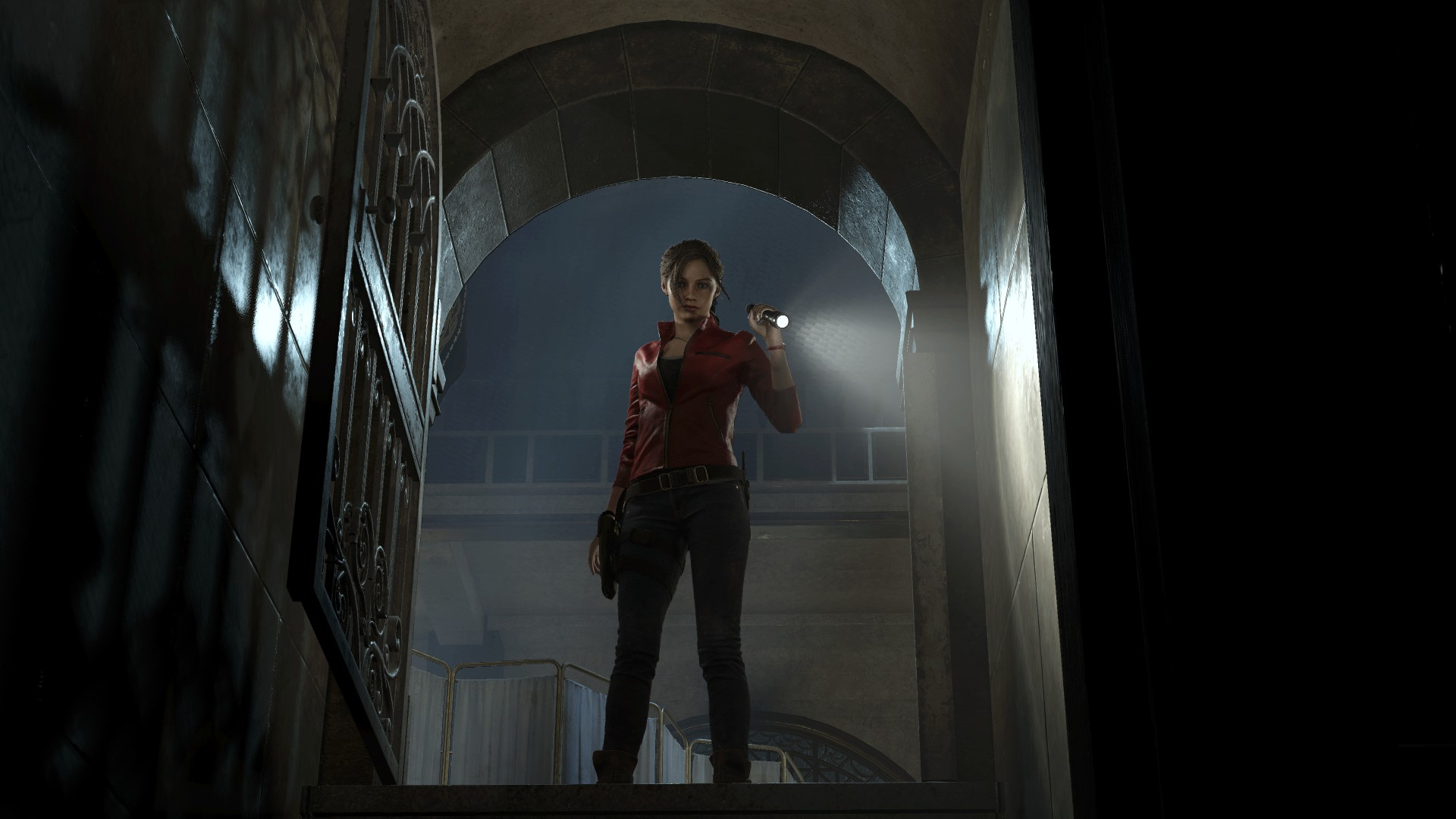 Claire Redfield using a torch to look into a crypt of some sort.
