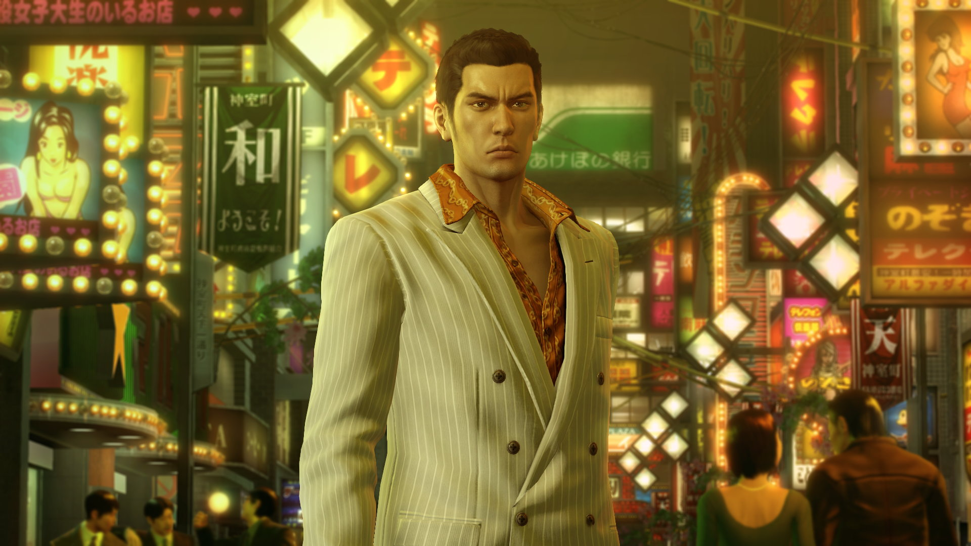 Kazuma Kiryu, protagonist of Yakuza 0, stands in busy a street. Many neon signs crowd the buildings behind him.