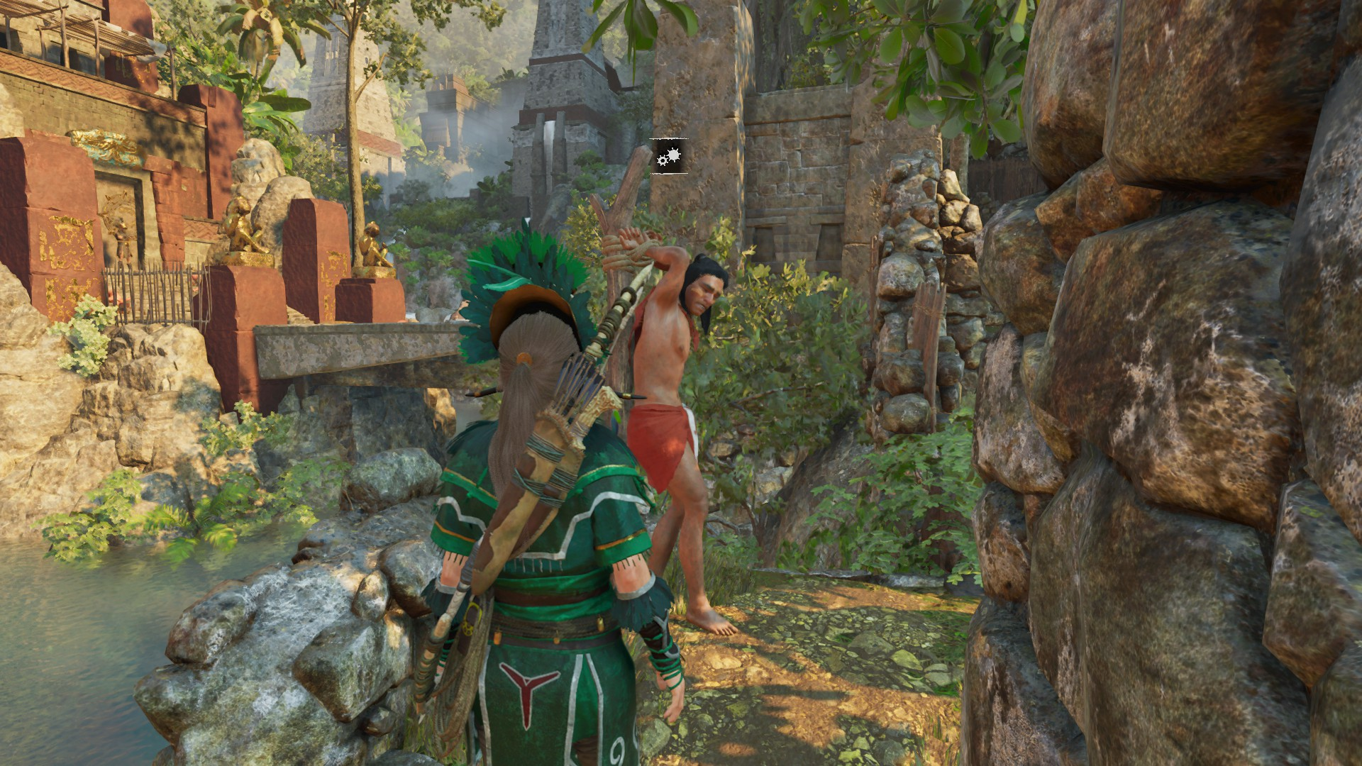 Lara in disguise looks at a tied up rebel.