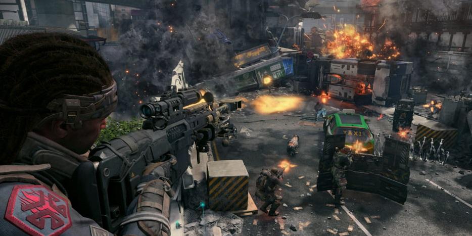 A gruff man points his gun at an explosion