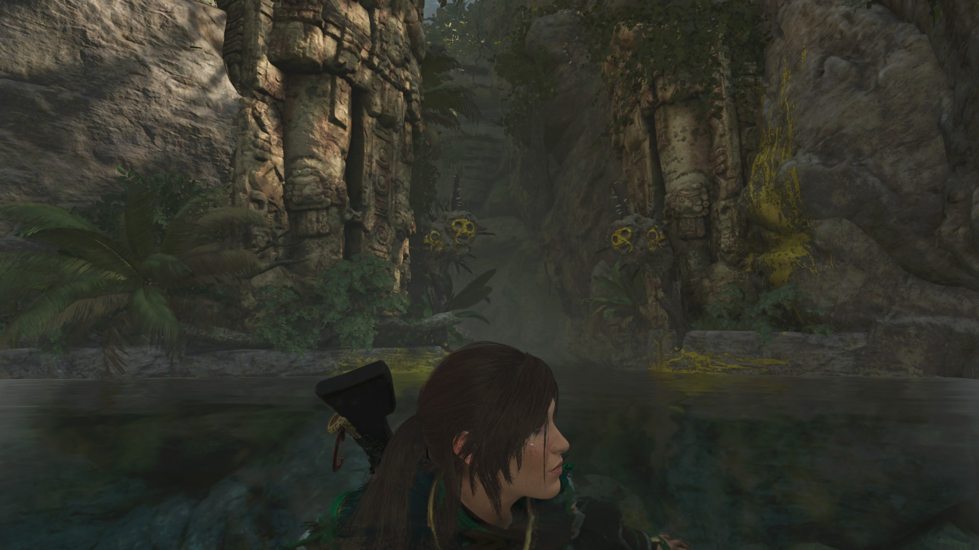 Lara swimming in the lake east of Ruined Tower base camp across the broken logs. She is outside the Thirsty Gods challenge tomb.