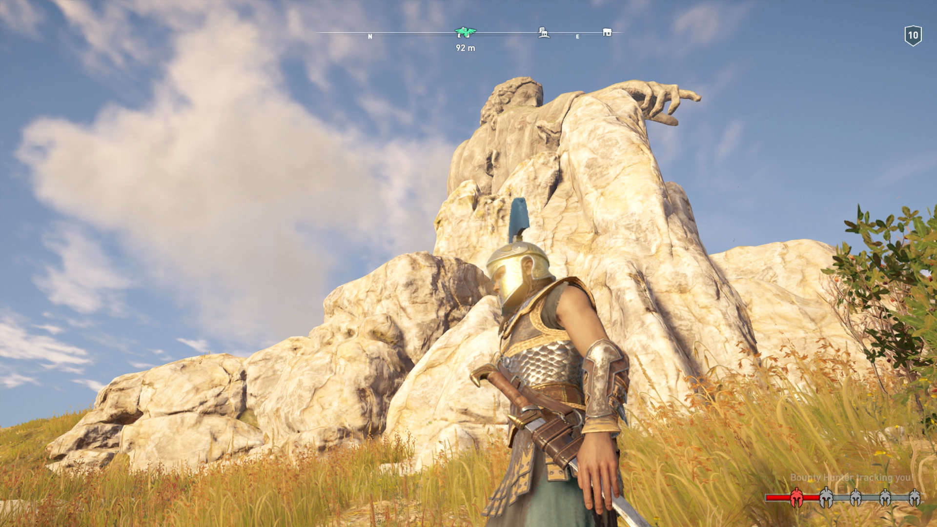 Kassandra is standing at the foot of the Statue of Zeus