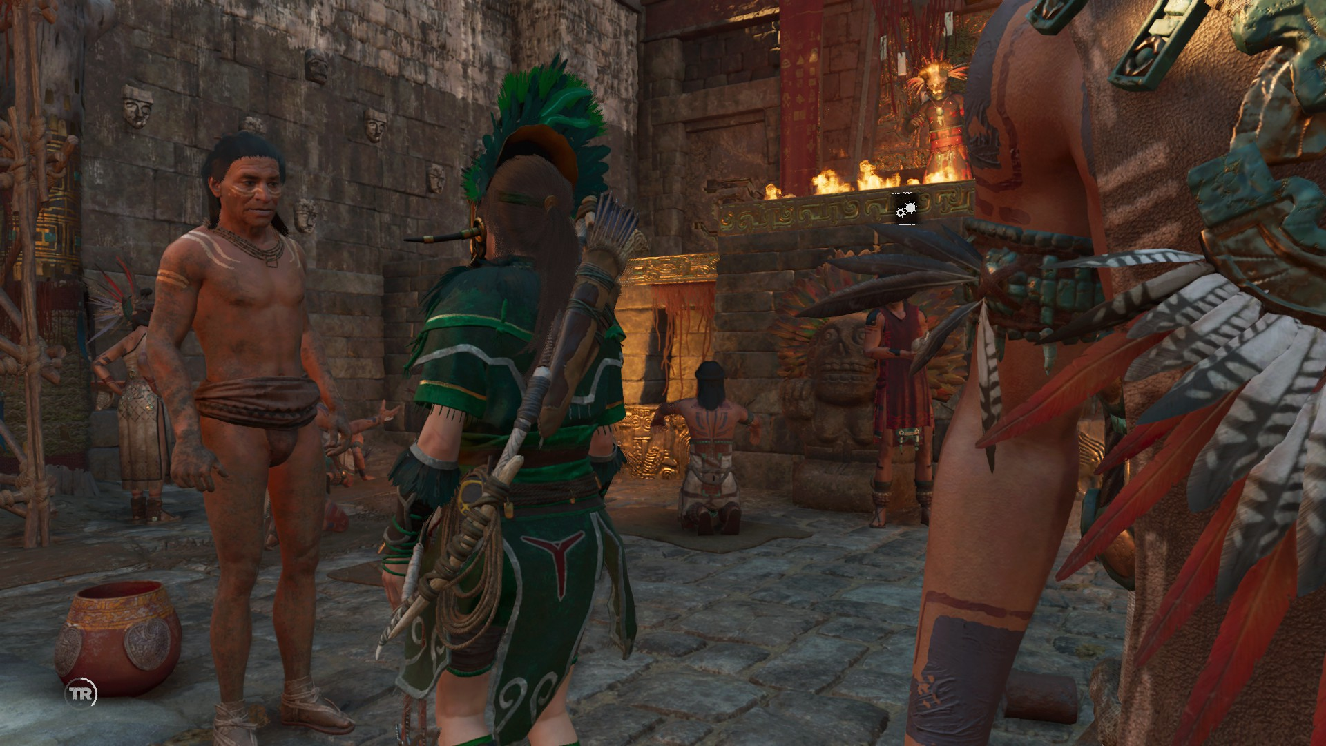Lara talking to a rebel in the temple area.