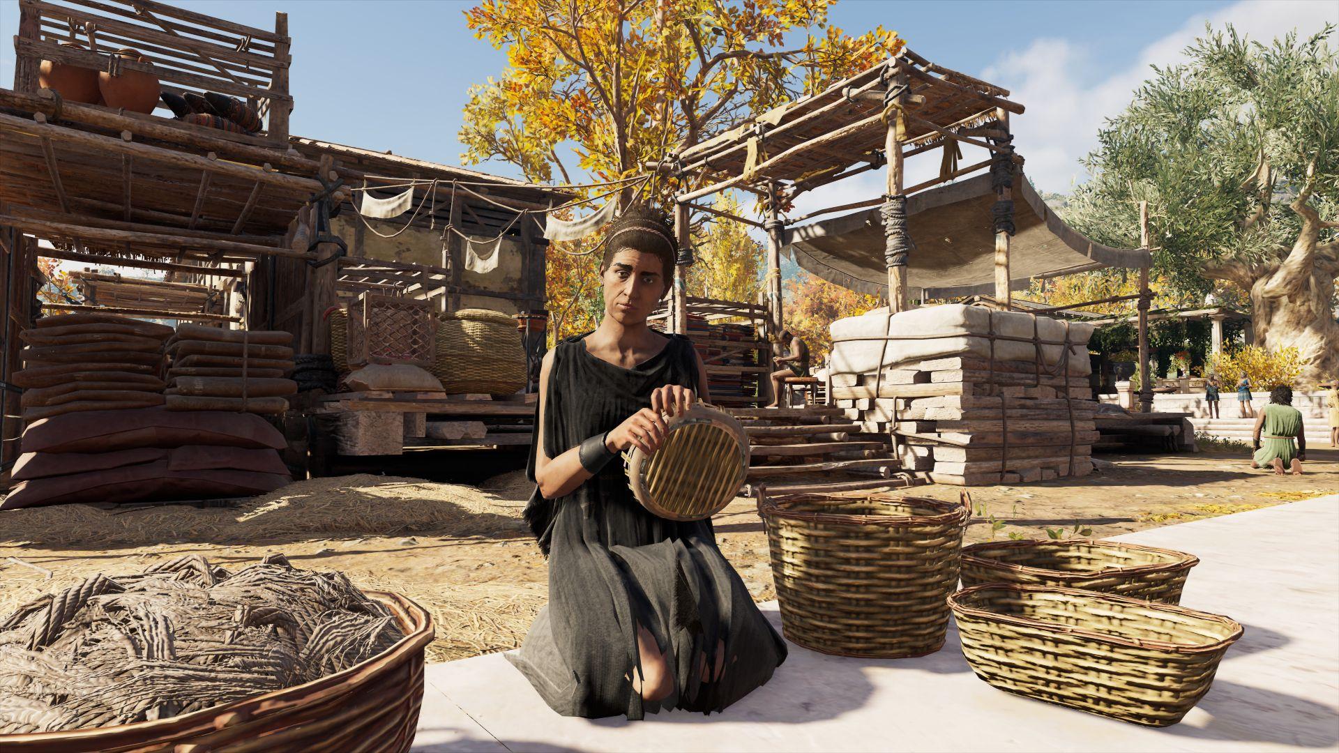 A woman weaving a basket.