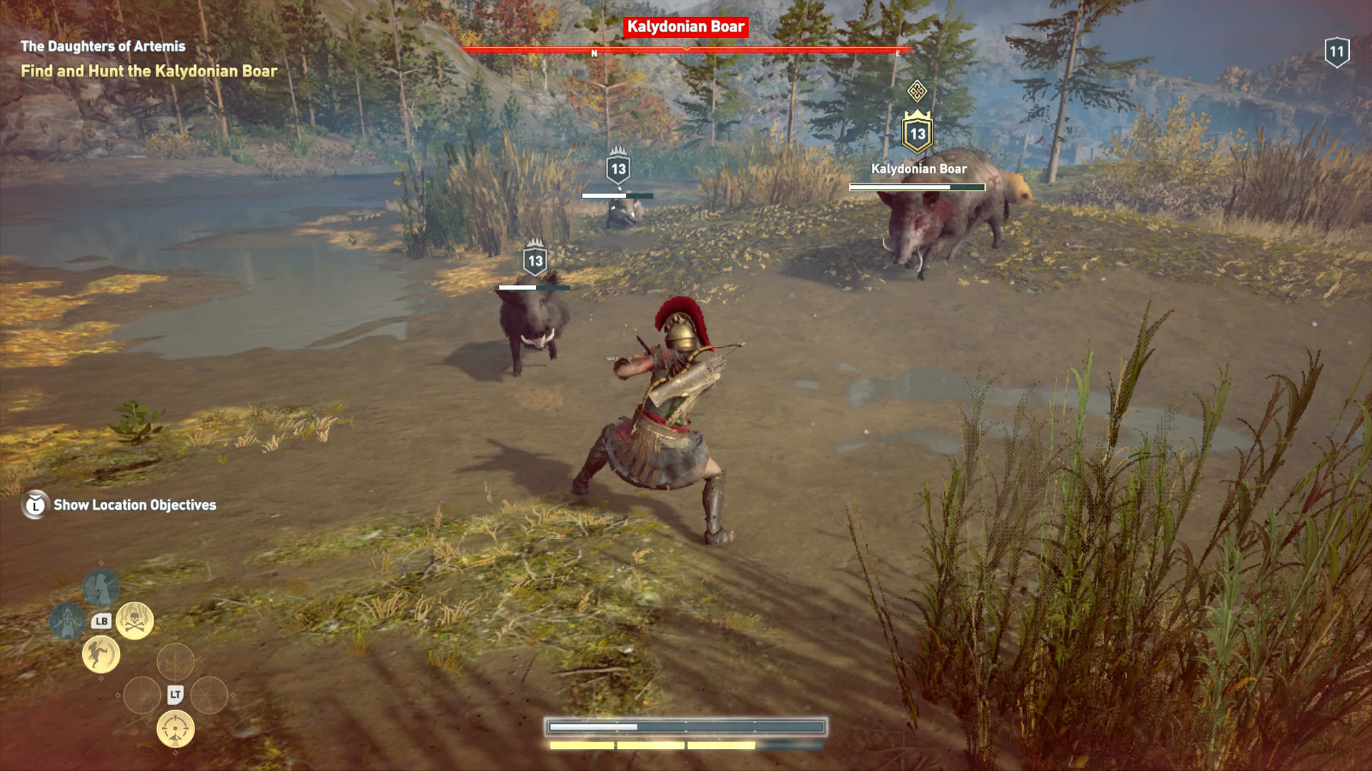 Kassandra is fighting against the Kalydonian Boar and its four smaller boar offspring.