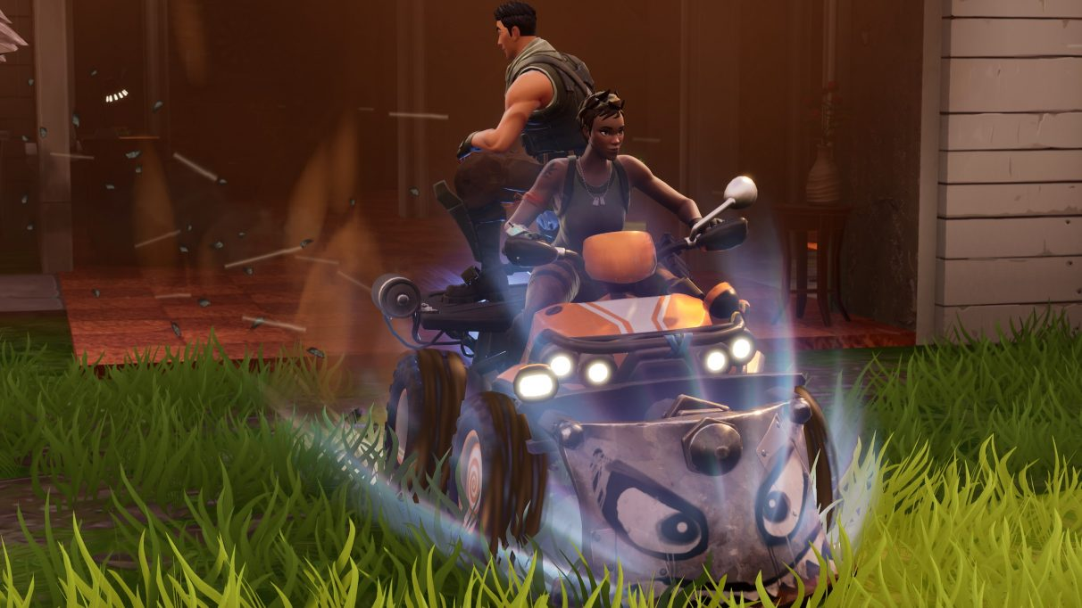 Two players riding the Fortnite Quad.