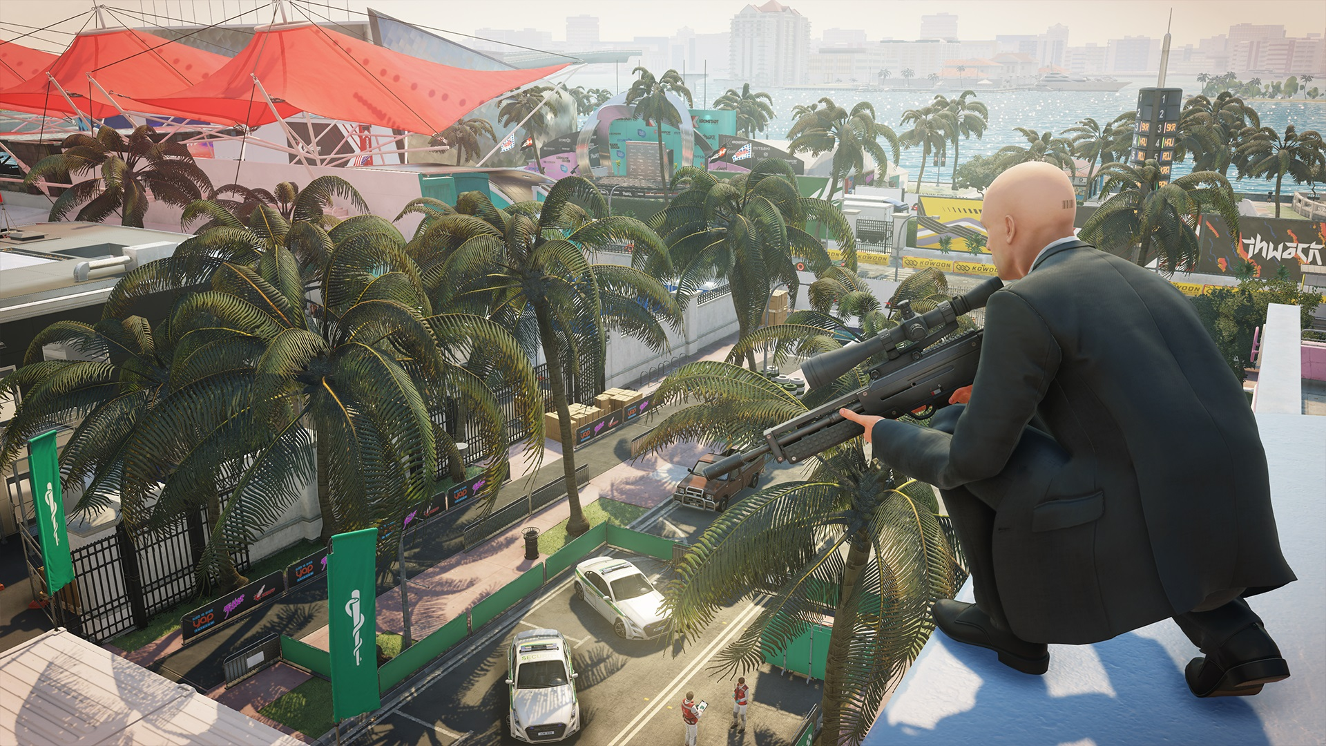 Agent 47 perched on a rooftop with a sniper rifle.