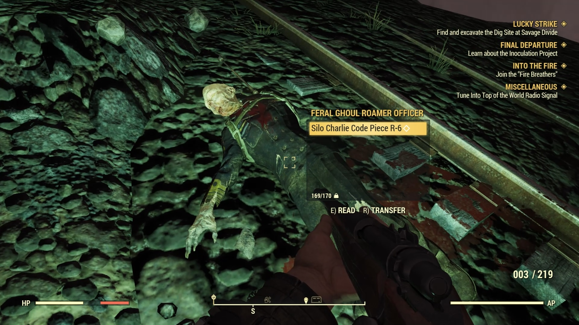 Player is looking down at a deceased Feral Ghoul officer with the nuclear code.