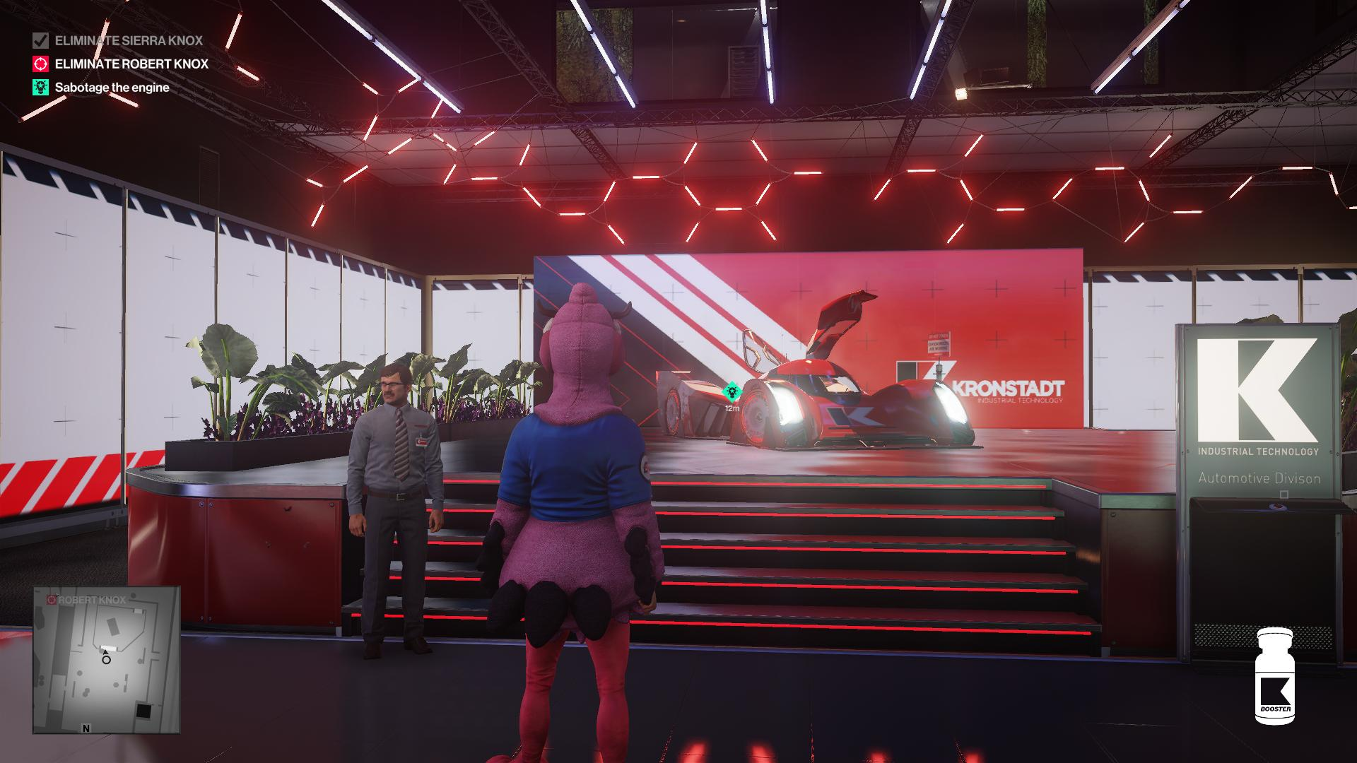 Agent 47, disguised as a mascot, looking at the race car on a podium. One security guard is standing watch.