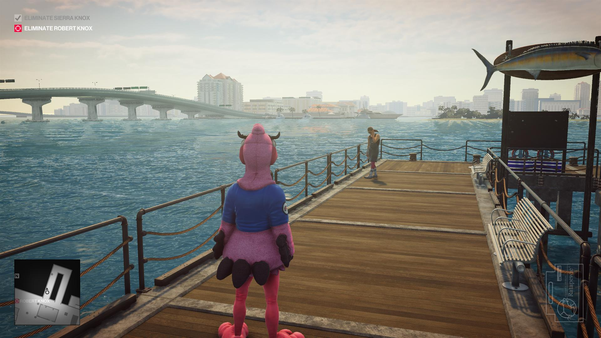 Agent 47 still in the mascot costume, walking on a dock towards a man with a bandana.