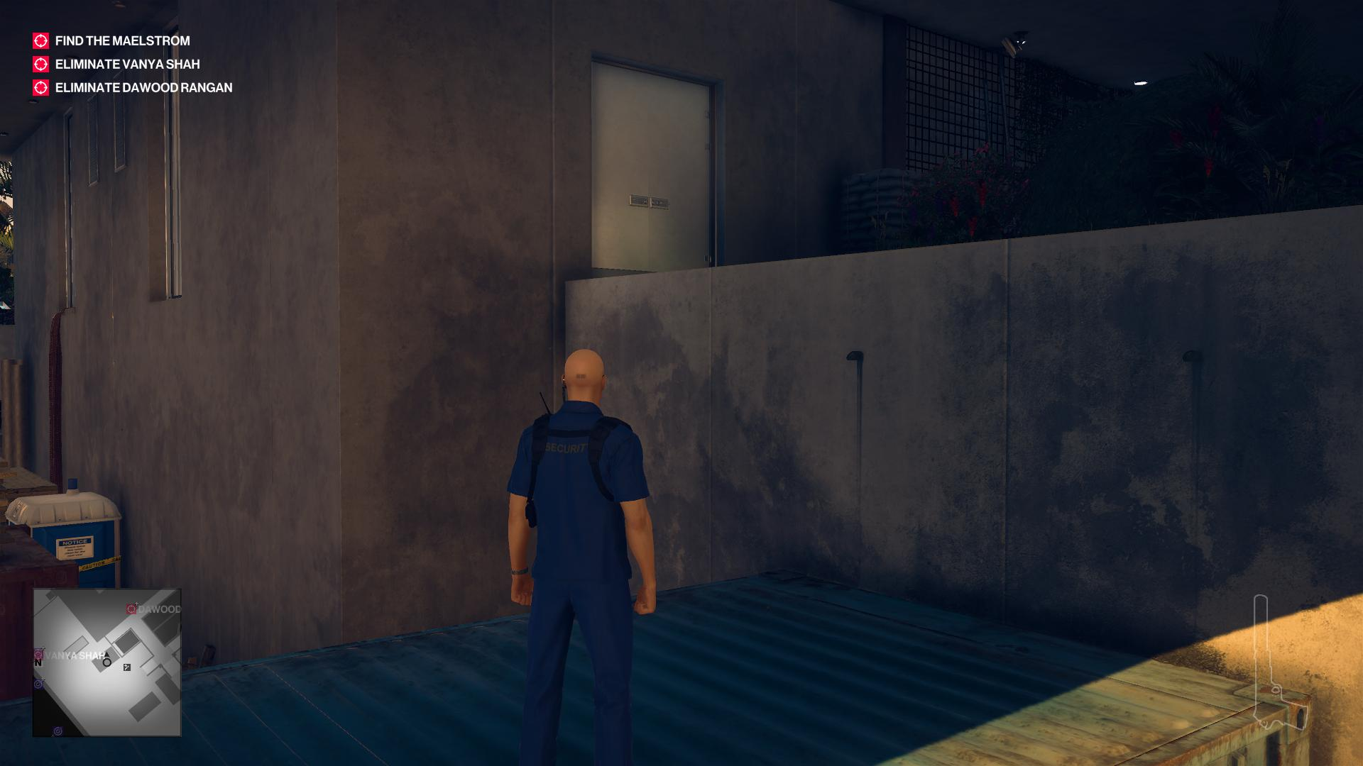 Agent 47 dressed as a security guard climbing on top of a shipping container.