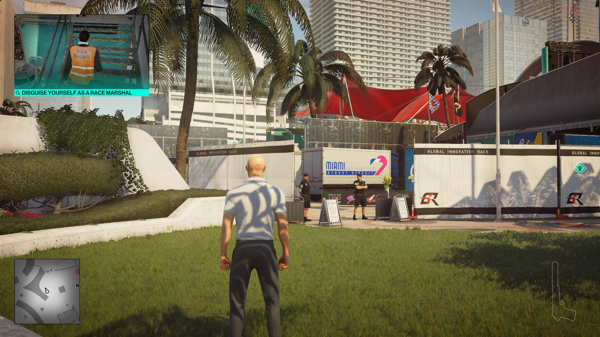 Agent 47 standing on the grass like a naughty man. Two guards are blocking the way to a van.