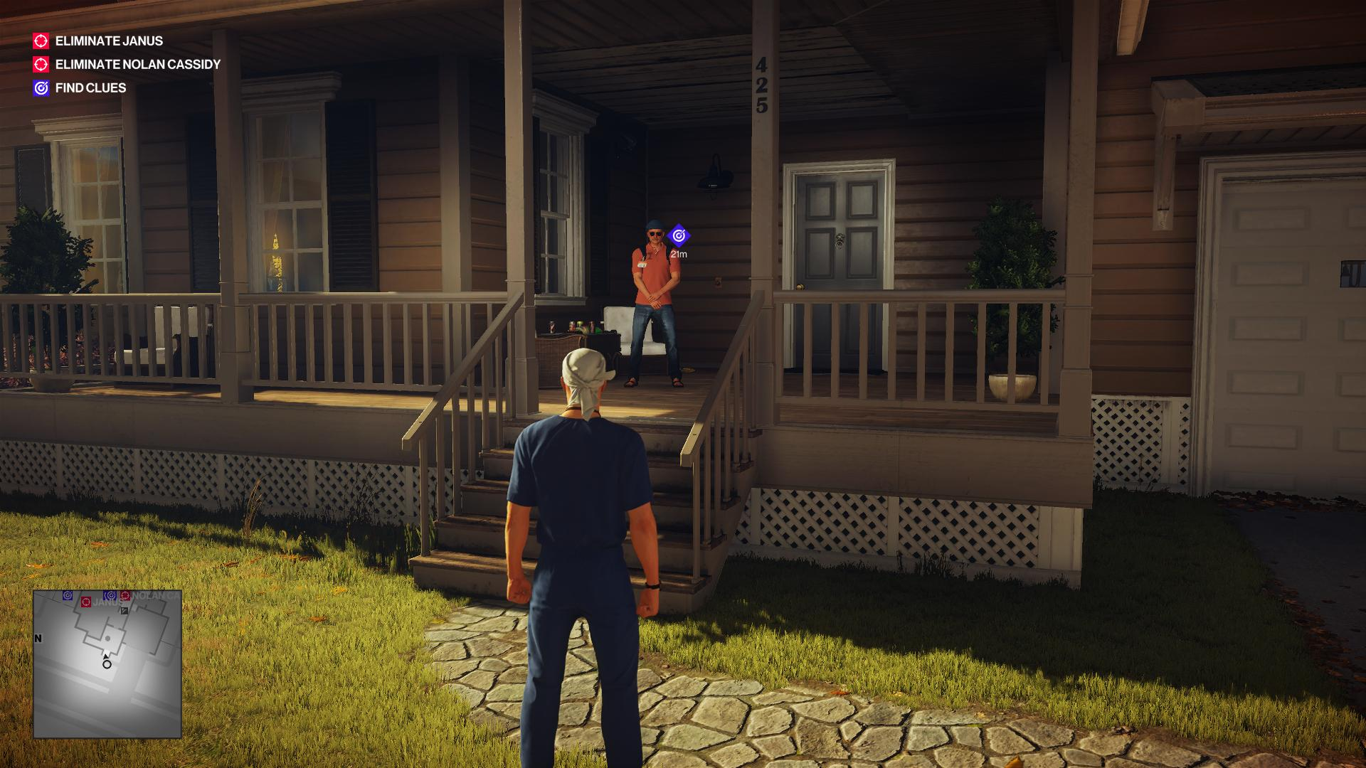 Agent 47 in a bandana and nurse scrubs, approaching the porch of a man in a pink shirt. He's standing rather awkwardly on guard.