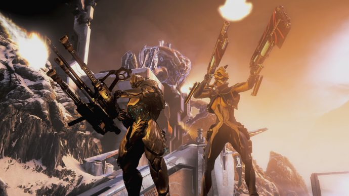 Two characters pose with their weapons in Warframe.