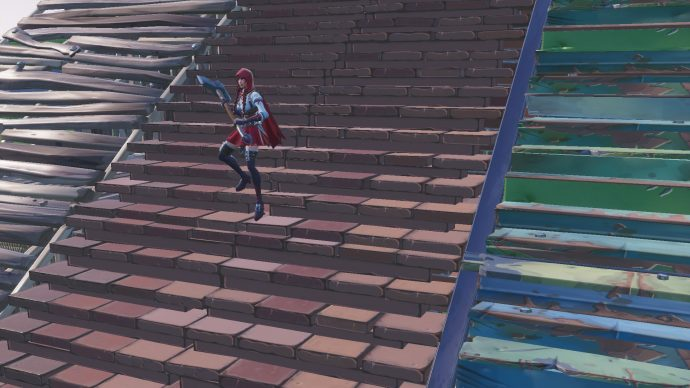 Player is walking down brick stairs with metal and wooden stairs either side.