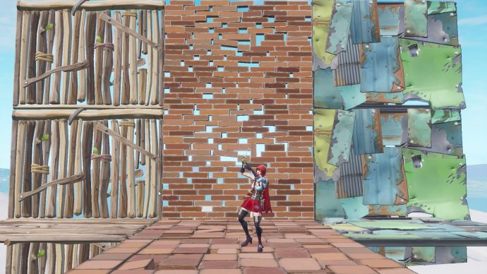 Player standing in front of three walls. One of wood, one of brick, and one of metal.