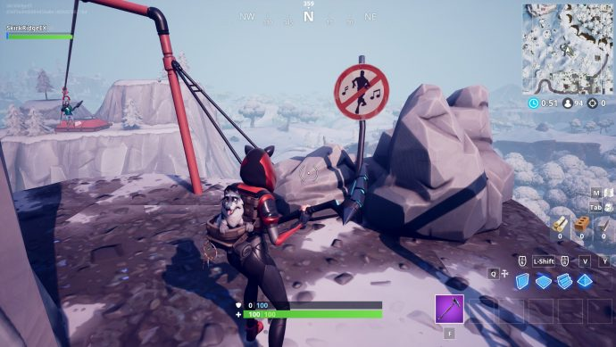 On top of the weird mountain south-west of Dusty Divot. There's a no dancing sign there.