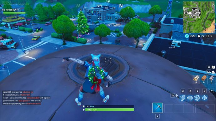 Doing a merry jig on top of the water tower in Retail Row.