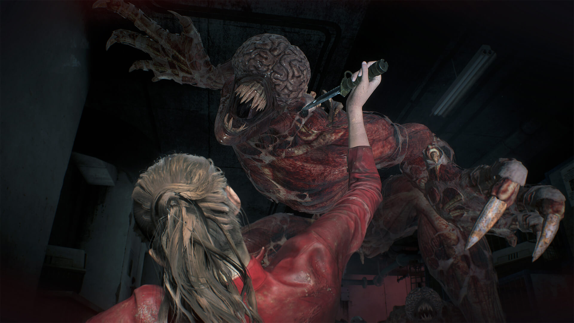 Claire Redfield defending herself against a Licker with a knife.