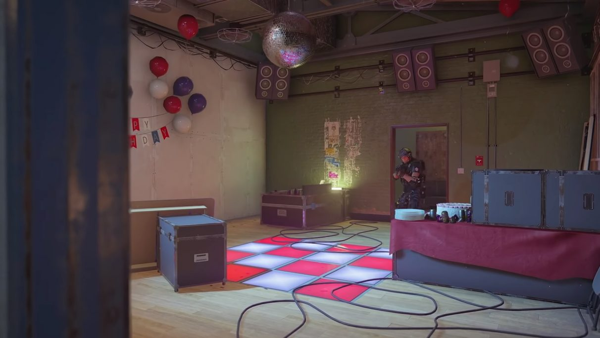 The disco room with an operator moving through it. A disco ball is spinning.