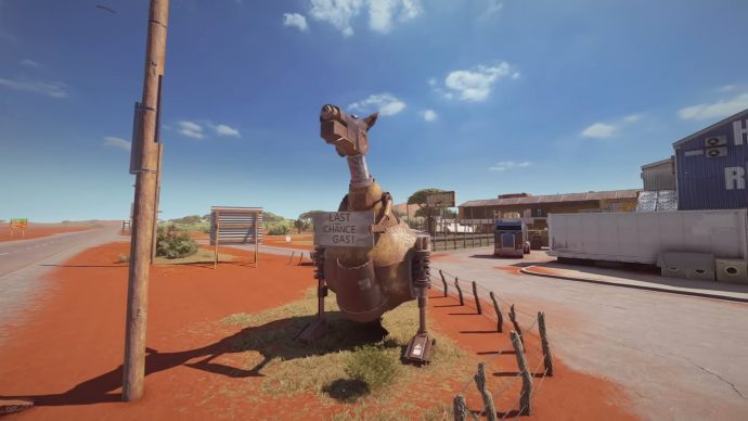 "A metal kangaroo with a sign saying ""Last Chance Gas!"" that stands outside of Hanley's Roadhouse."