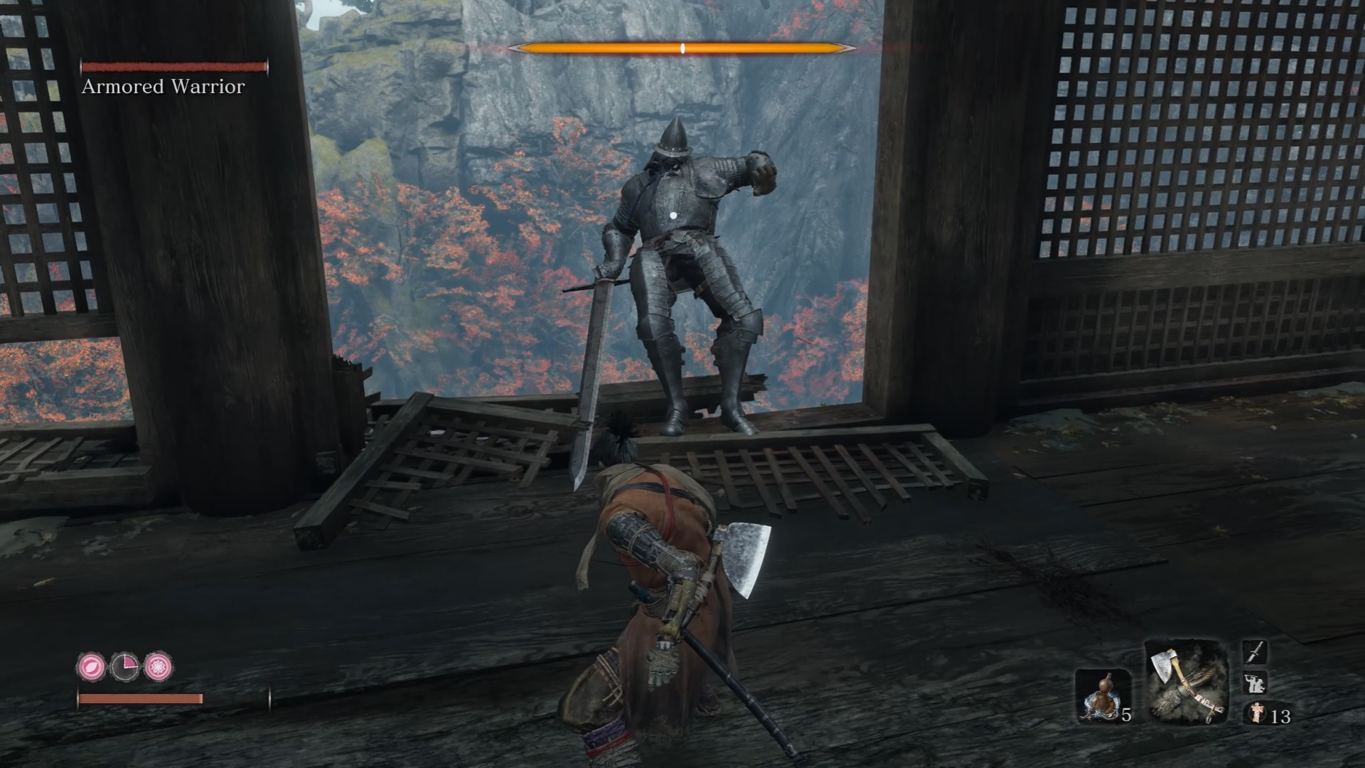 The Armored Knight has been staggered by a posture break. He's about to comically fall out of a window he made.