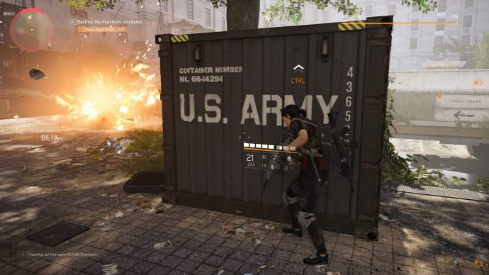 Hunking behind a US Army supply crate as explosions can be seen to the left.