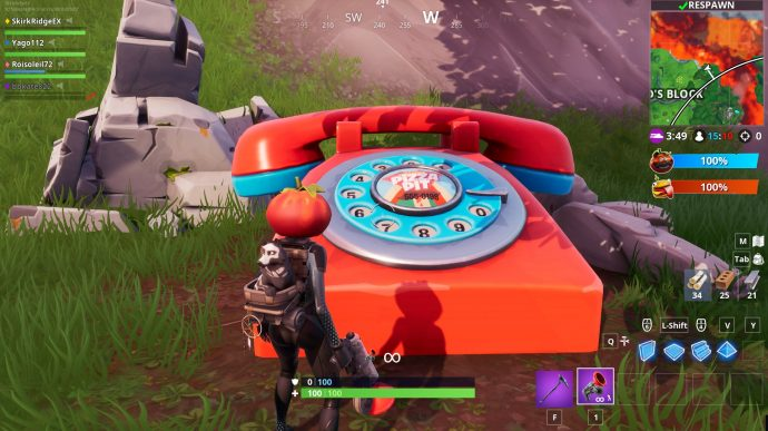 A big phone close to The Block. It has Pizza Pit on it and a phone number - 555-0198.
