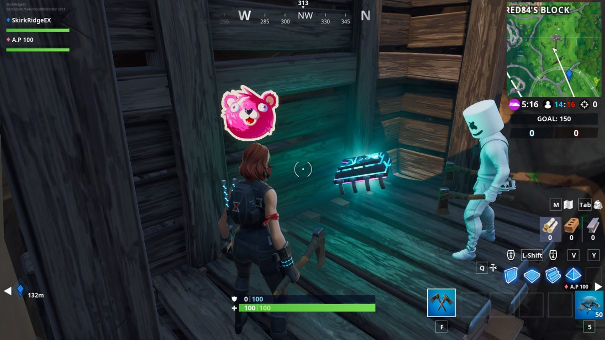 A couple of players gathered in the excavated umbrella handle, showing the cuddle up emoticon of a pink bear.