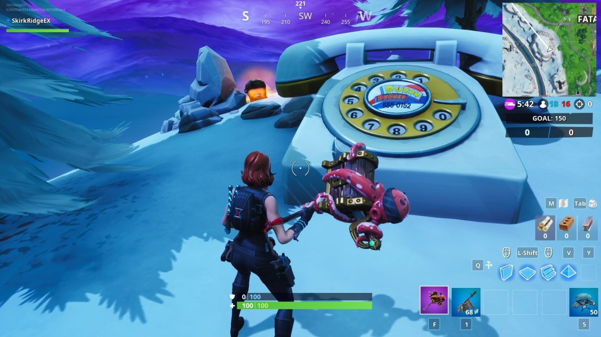Oversized phones are still in the same locations as Season 8. This one is on the frosty mountain close to Fatal Fields.