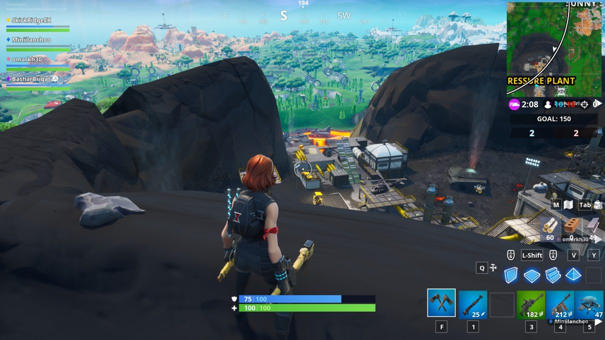 The small rock to the left of the player is the rock you need to hit with the Bunker Basher pickaxe.