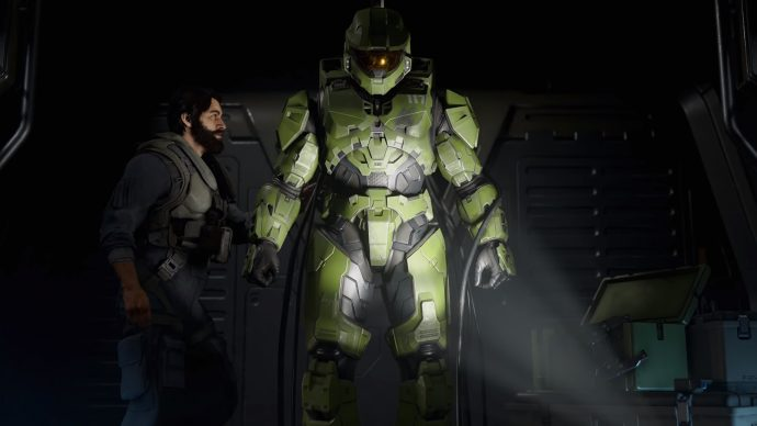 Master Chief, currently inactive, as a man attempts to reactivate him.