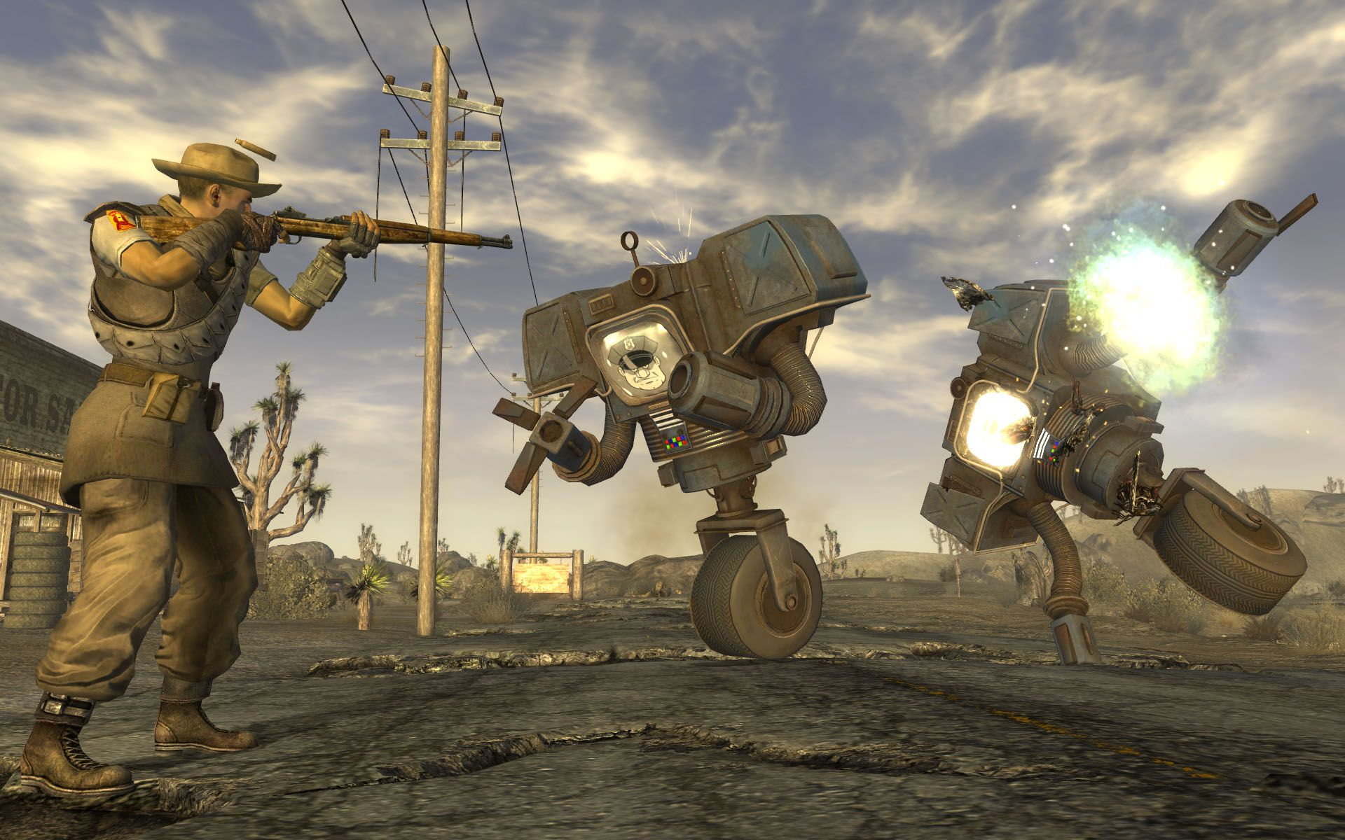 A screenshot of a man shooting two robots in Fallout: New Vegas.