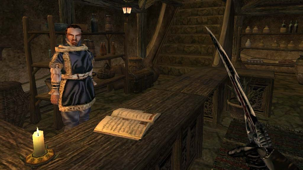 A screenshot of a grumpy merchant inside a shop in The Elder Scrolls 3: Morrowind.