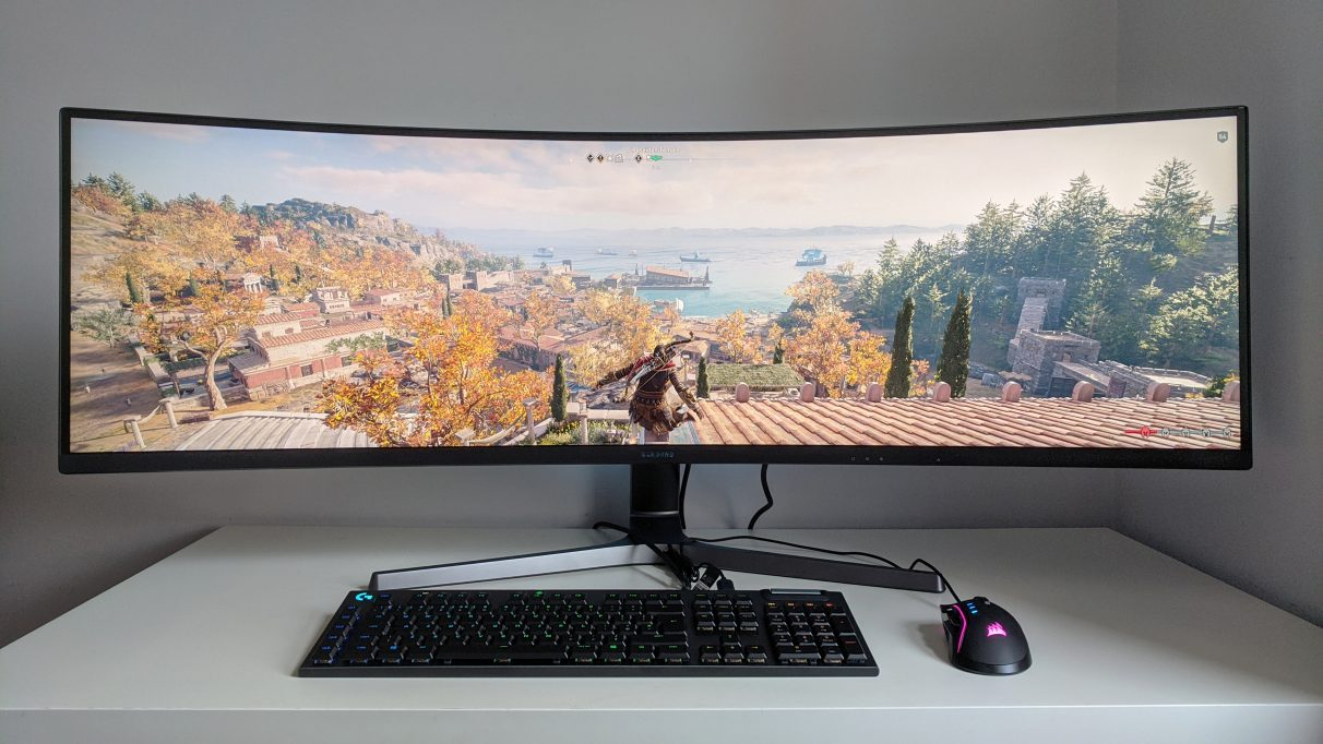 A photo of Assassin's Creed Odyssey running on an ultrawide monitor.