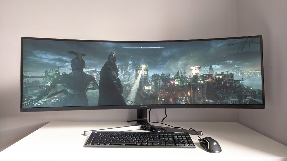 A photo of Batman: Arkham Knight running on an ultrawide monitor.