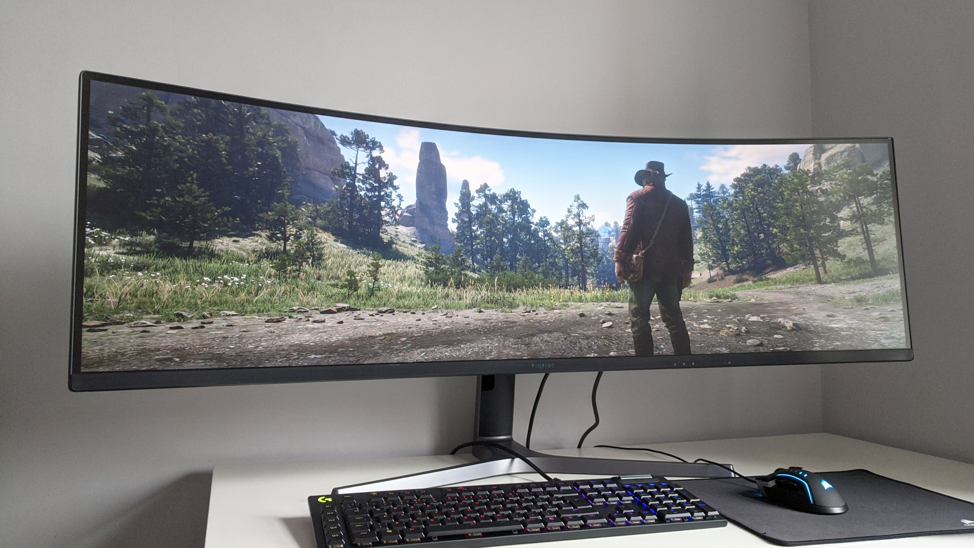 A photo of Red Dead Redemption 2 running on an ultrawide monitor.