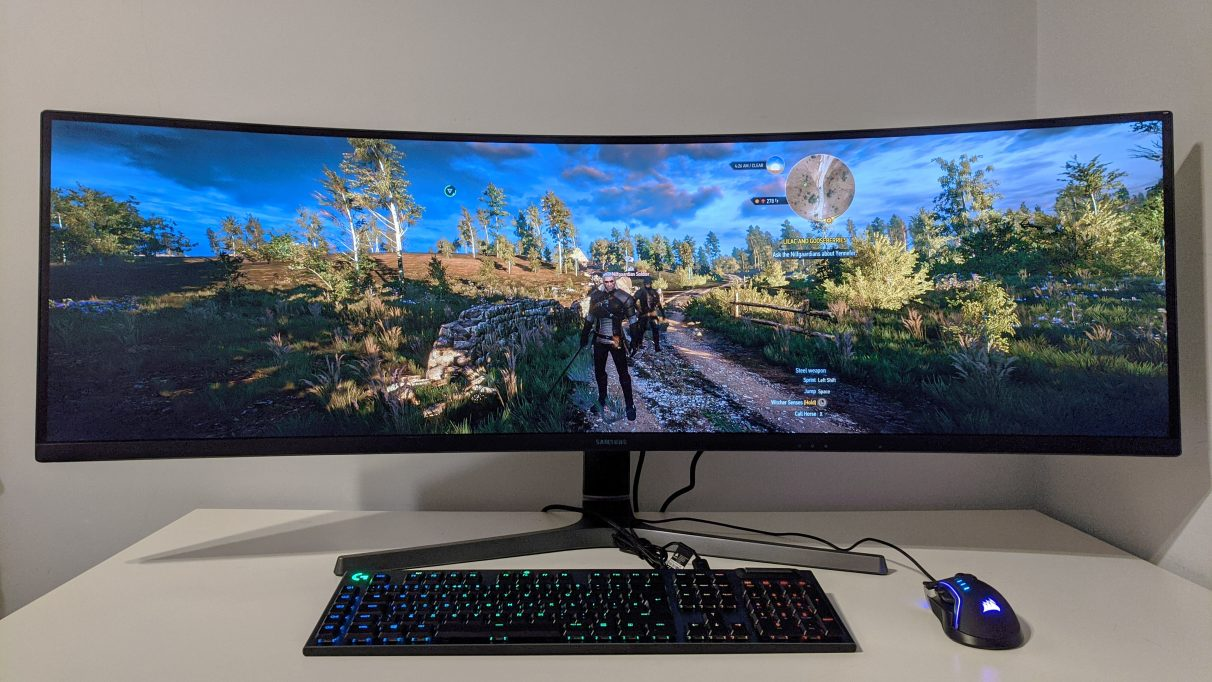 A photo of The Witcher III: Wild Hunt running on an ultrawide monitor.