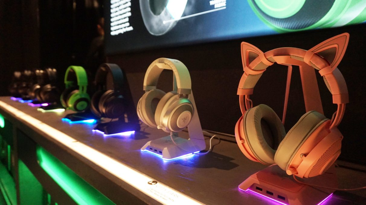 A photo of several Razer gaming headsets on headset stands.