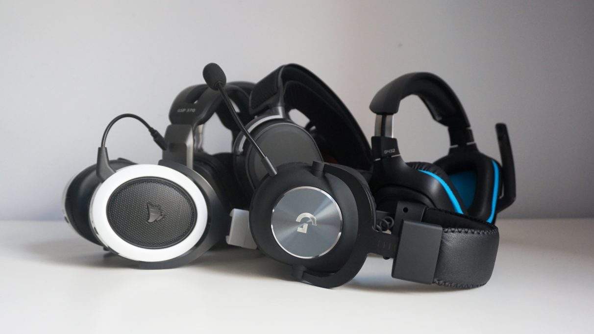 A collection of gaming headsets on a table.