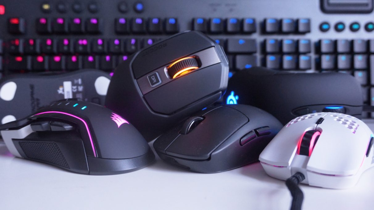 A photo showing several different gaming mice at various angles in front of a keyboard.