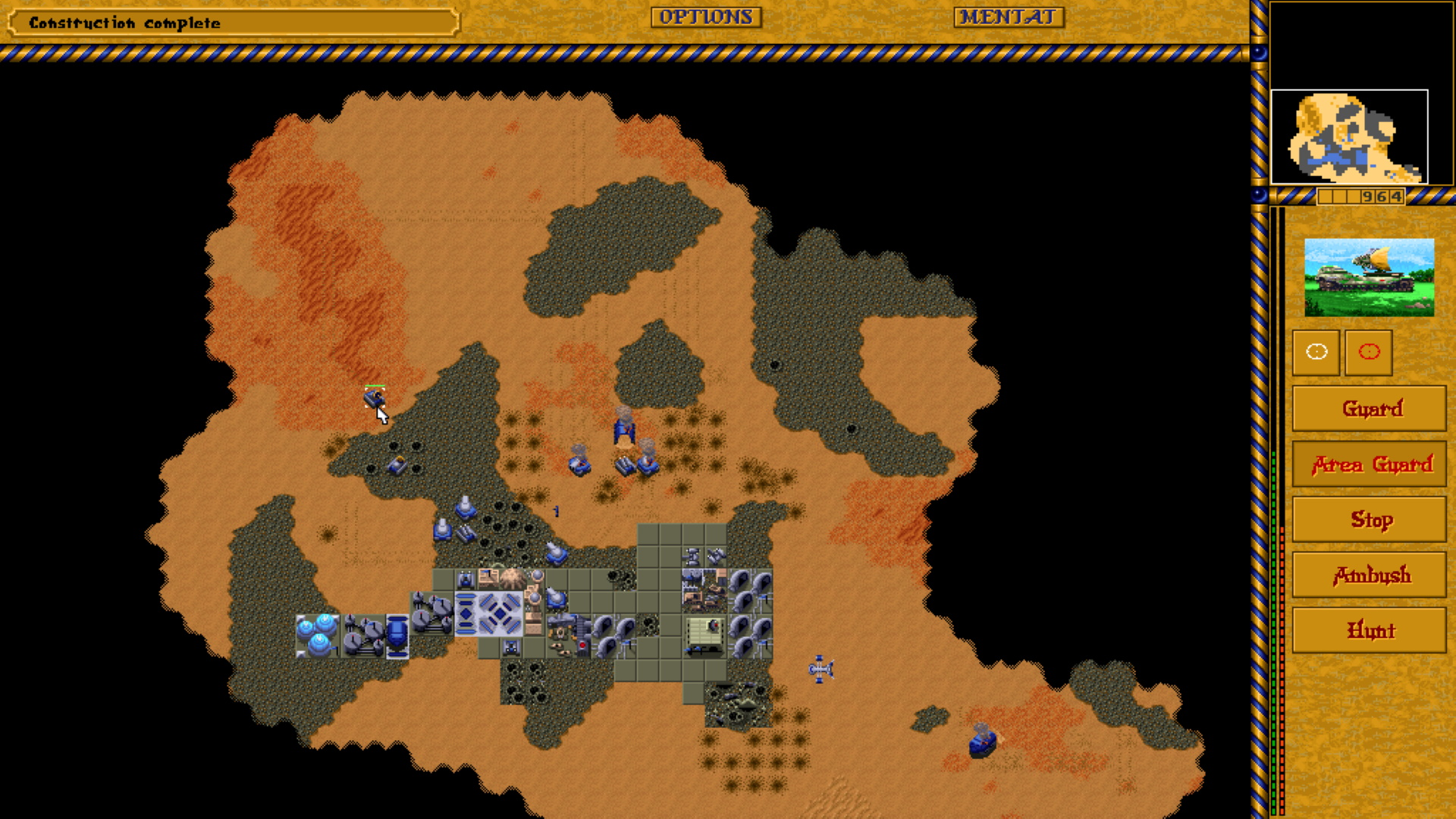 A screenshot of an early base in Dune II Legacy.
