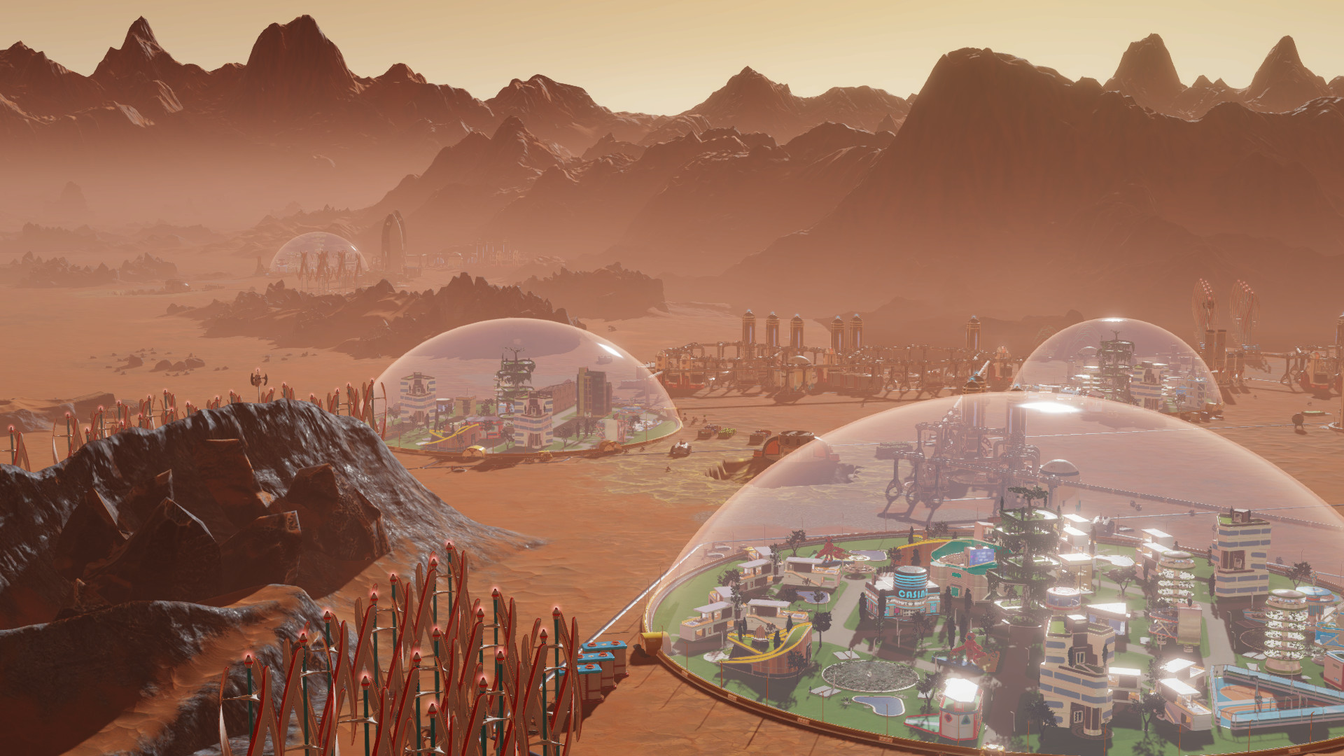 A screenshot showing four bubble colonies on the surface of Mars in Surviving Mars.